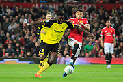 Burton Albion midfielder Hope Akpan (21) is fouled by Manchester United midfielder Jesse Lingard (14) during the EFL Cup match between Manchester United and Burton Albion at Old Trafford, Manchester, England on 19 September 2017. Photo by Richard Holmes