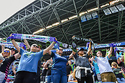 Seattle Sounders fans stand and hold scarves before the match between the New England Revolution and the Seattle Sounders on Saturday, Aug. 10, 2019, in Seattle. (Alika Jenner/Image of Sport)