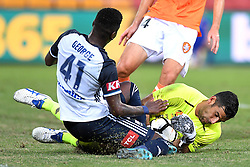 December 17, 2017 - Brisbane, QUEENSLAND, AUSTRALIA - Jamie Young of the Roar (21, right) makes a save against Leroy George of Melbourne Victory (41) during the round eleven Hyundai A-League match between the Brisbane Roar and the Melbourne Victory at Suncorp Stadium on Sunday, December 17, 2017 in Brisbane, Australia. (Credit Image: © Albert Perez via ZUMA Wire)