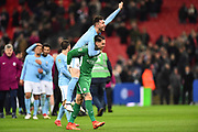 Ederson Moraes (31) of Manchester City and Aymeric Laporte (14) of Manchester City celebrate at full time after the 3-0 win over Arsenal during the EFL Cup Final match between Arsenal and Manchester City at Wembley Stadium, London, England on 25 February 2018. Picture by Graham Hunt.