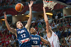 Nando de Colo of France, Boris Diaw of France and Ersan Ilyasova of Turkey during  the eight-final basketball match between National teams of Turkey and France at 2010 FIBA World Championships on September 5, 2010 at the Sinan Erdem Dome in Istanbul, Turkey. (Photo By Vid Ponikvar / Sportida.com)
