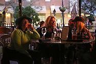 BRENDAN FITTERER     VISIT FLORIDA<br /> Maren Jalladeau, left, Annabel Serio, center, and Julie Miller listen to Mark Serio and Friends perform at Mattison's City Grille downtown Sarasota, 1 North Lemon Ave Sarasota, FL 34236.