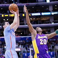 06 April 2014: Los Angeles Clippers guard J.J. Redick (4) takes a jumpshot over Los Angeles Lakers guard Jodie Meeks (20) during the Los Angeles Clippers 120-97 victory over the Los Angeles Lakers at the Staples Center, Los Angeles, California, USA.