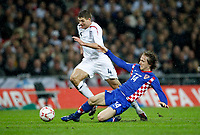 Photo: Richard Lane/Sportsbeat Images.<br />England v Croatia. UEFA European Championships Qualifying. 21/11/2007. <br />England's Steven Gerrard is challenged by Croatia's Luka Mordric.