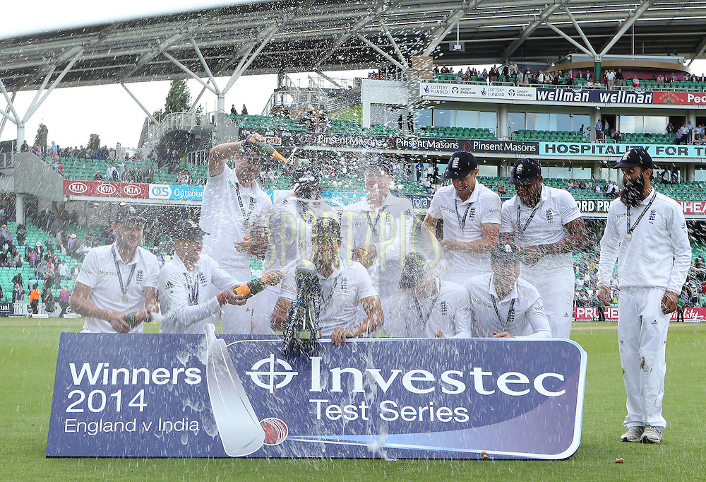 Alastair Cook captain of England and England celebrate the series win during day three of the fifth Investec Test Match between England and India held at The Kia Oval cricket ground in London, England on the 17th August 2014<br /> <br /> Photo by Ron Gaunt / SPORTZPICS/ BCCI
