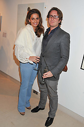JORIE GRASSIE and GRAHAM STEELE at the launch Sanctuary, Britains Artists and their Studios held at Christies, 8 King Street, St.James's, London on 13th March 2012.