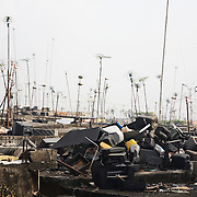 Electronic waste export to Nigeria...Alaba International Market, one of the largest markets for electronic goods in West Africa.  New and old - and a lot of non-working electronic goods such as TVs and computers come in to the market via Lagos harbour from the US, Western Europe and China. A roof top covered in TV casings and antennaes..The shipment - TV-set originally delivered to municipality-run collecting point in UK for discarded electronic products - was tracked and monitored by Greenpeace using a combination of GPS (Global Positioning System using satellites), GSM (positioning using data from mobile networks to triangulate approximate positions) and an onboard radiofrequency transmitter (used for making triangulations in combination with handheld directional receivers used by team on ground) is placed inside the TV-set.  The TV arrived in Lagos in container no 4629416.