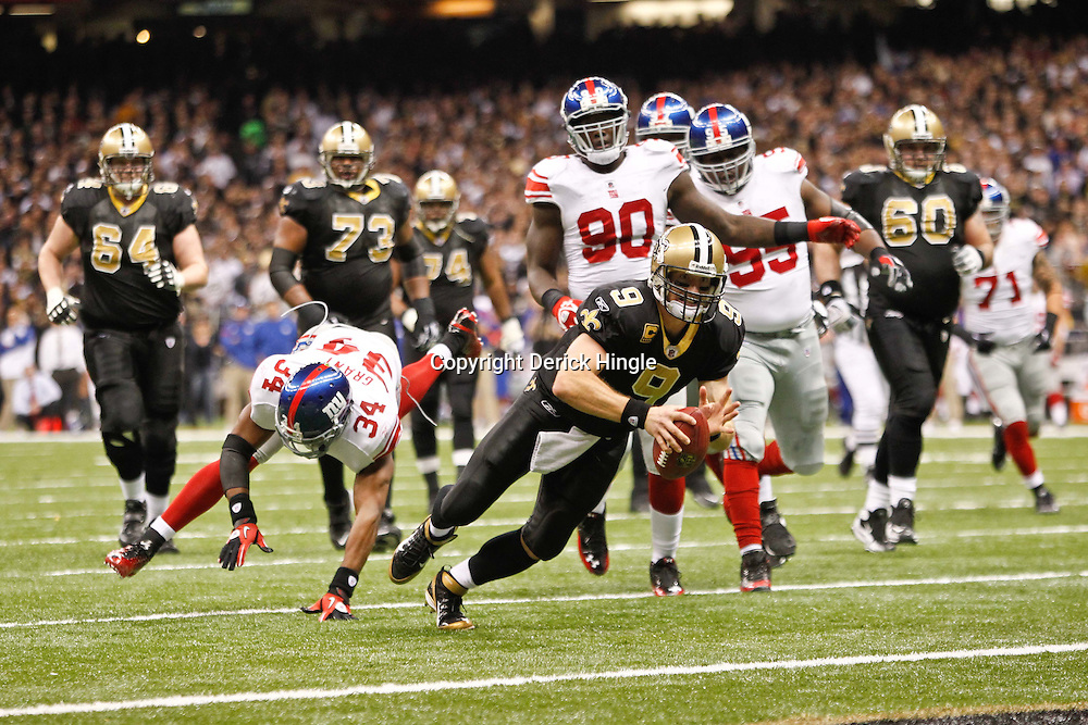 November 28, 2011; New Orleans, LA, USA; New Orleans Saints quarterback Drew Brees (9) dives into the endzone for a touchdown during the second half of a game against the New York Giants at the Mercedes-Benz Superdome. The Saints defeated the Giants 49-24. Mandatory Credit: Derick E. Hingle-US PRESSWIRE