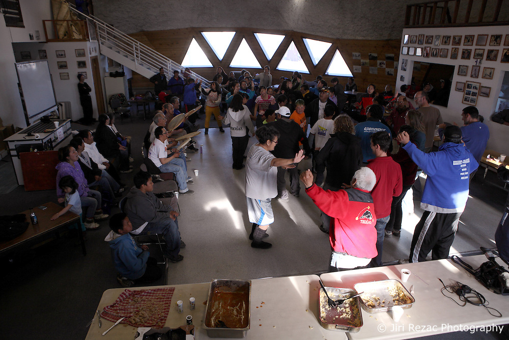 USA ALASKA POINT HOPE 22JUL12 - Inupiat residents of Point Hope sing and dance together with members of the Greenpeace ship Esperanza crew during a community meeting and dance at Point Hope, North Slope Borough, Alaska...Music is important for the Inupiat people living in the Arctic: most families have their own songs and dances that have been handed down from their ancestors ..Point Hope is one of the oldest continually occupied sites in North America.......Photo by Jiri Rezac / Greenpeace..© Jiri Rezac / Greenpeace