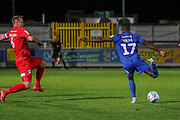 AFC Wimbledon attacker Michael Folivi (17) with a shot on goal during the Leasing.com EFL Trophy match between AFC Wimbledon and Leyton Orient at the Cherry Red Records Stadium, Kingston, England on 8 October 2019.