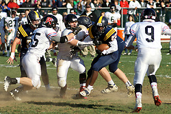 Philadelphia, PA, United States, November 9, 2019: Young male student athletes compete in 'the oldest uninterrupted schoolboy football rivalry in the US&quot; as part of the annual PC/GA Day sports event.<br /> <br /> The annual football rivalry is the main event of the sportive meet between two Philadelphia Area private schools: William Penn Charter School and Germantown Academy. At the 127th edition the GA Patriots break a long standing winning streak of the Penn Charter Quakers.<br /> <br /> 127th edition of the PC/GA day is held on the campus of William Penn Charter School in the Northwest section of Philadelphia, PA, USA on November 9, 2013.<br /> <br /> ( This file is also available for online licensing in my iStock.com portfolio: http://www.istockphoto.com/search/portfolio/605863/?facets=%7B%2225%22%3A%226%22%7D#bd0812 )