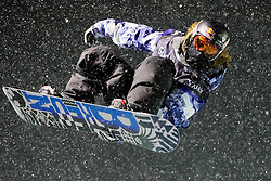 Shaun White goes airborne in a snow storm at the U.S. Snowboarding Grand Prix finals, Saturday, Jan. 23, 2010, in Park City, Utah. (AP Photo/Colin E Braley).