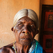 India 2014. Orissa. Bwanipatna. A tribal woman with cataracts waits to be taken for surgery.