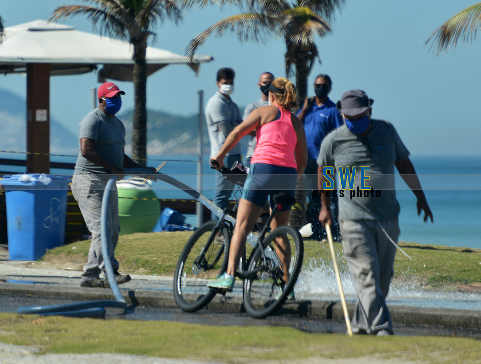 Rio de Janeiro-Brazil12 May 2020 Workers wash the boardwalk at Barra da Tijuca beach during the coronavirus pandemic (COVID19)