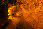 Visitors inside the Thurston Lava Tube, Hawaii Volcanoes National Park, Hawaii USA