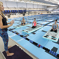 Adam Robison | BUY AT PHOTOS.DJOURNAL.COM<br /> Kristi Paxton, yoga instructor for Bogafit, gets her class started at the Tupelo Aquatic Center on Monday morning. Bogafit is yoga on-mats-in-the-pool exercise program and is controlled instability to help build better core strength.
