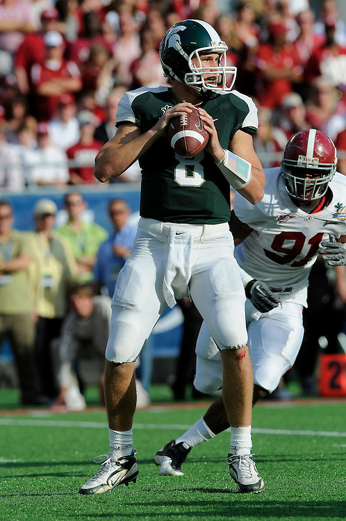 January 1, 2011: Kirk Cousins of the Michigan State Spartans drops back to pass during the NCAA football game between the Michigan State Spartans and the Alabama Crimson Tide at the 2011 Capital One Bowl in Orlando, Florida. Alabama defeated MSU 49-7.