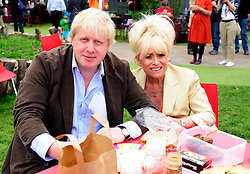 © licensed to London News Pictures. London, UK  05/06/11. Boris Johnson and Barbara Windsor celebrate this year's Big Lunch in the newly created roof garden on the Queen Elizabeth Hall, London. Local residents and gardeners from the Providence Row Housing Association took part in a picnic-style lunch in the gardens overlooking the Thames. The Mayor provided funding to help develop the roof garden as part of his Capital Growth Scheme, to create 2,012 new food growing spaces in London by 2012.. Please see special instructions for usage rates. Photo credit should read Mary Stamm-Clarke/LNP