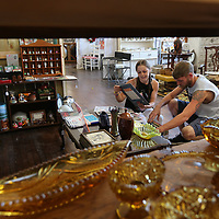 An and Jon Campbell browse through old records hoping to find something they like as they enjoy their Labor Day doing some shopping at Relic's in Downtown Tupelo.