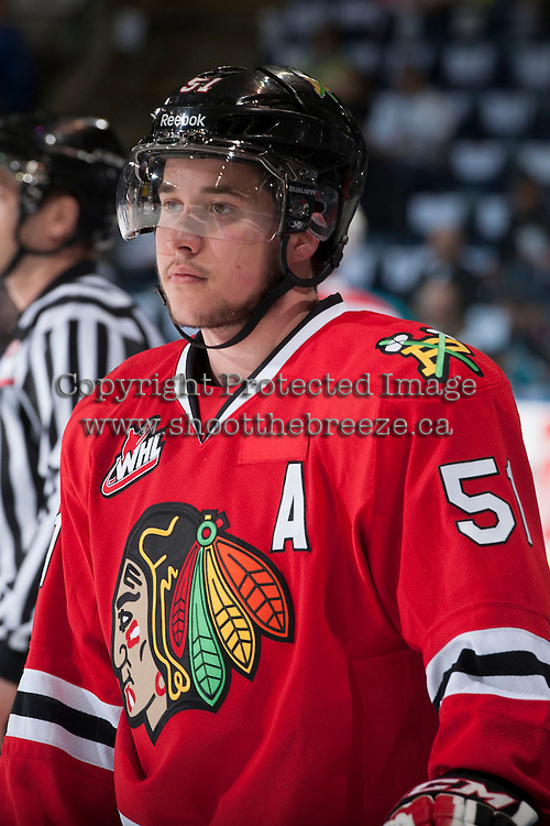 KELOWNA, CANADA - APRIL 18: Derrick Pouliot #51 of the Portland Winterhawks stands at the bench during warm up against the Kelowna Rockets on April 18, 2014 during Game 1 of the third round of WHL Playoffs at Prospera Place in Kelowna, British Columbia, Canada.   (Photo by Marissa Baecker/Shoot the Breeze)  *** Local Caption *** Derrick Pouliot;