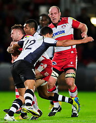 Gloucester Scrum-Half (#9) Dave Lewis is tackled by Fiji Inside Centre (#12) Josh Matavesi during the first half of the match - Photo mandatory by-line: Rogan Thomson/JMP - Tel: Mobile: 07966 386802 13/11/2012 - SPORT - RUGBY - Kingsholm Stadium - Gloucester. Gloucester Rugby v Fiji - International Friendly