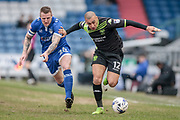James Vaughan (Bury) and Peter Clarke (Oldham Athletic) race for the ball during the EFL Sky Bet League 1 match between Oldham Athletic and Bury at Boundary Park, Oldham, England on 11 March 2017. Photo by Mark P Doherty.