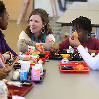 Lindsay Brett, Principal at Plantersville Middle School, visits with a group of fifth grade girls during their lunch time on Tuesday. Brett is this years Lee County School District's administrator of the year.