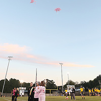 Lauren Wood | Buy at photos.djournal.com<br /> Pink balloons with the names of those who lost their lives to breast cancer float into the sky during the balloon release before the start of Friday night's football game at Pontotoc.