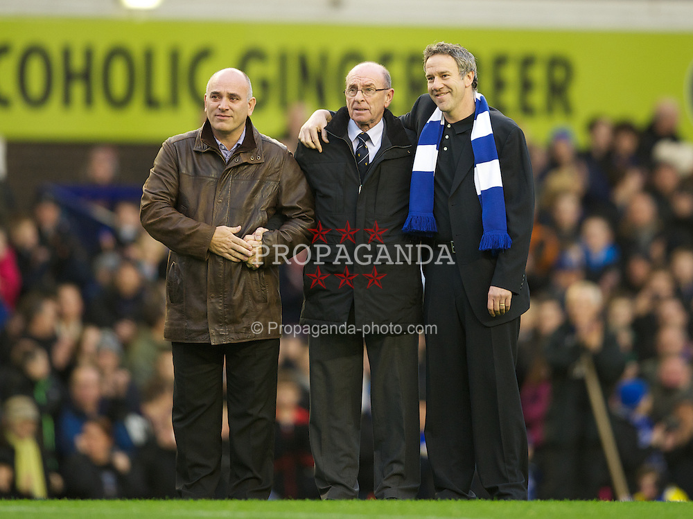 LIVERPOOL, ENGLAND - Sunday, December 4, 2011: Roger Speed, the father of former Everton player and Wales manager Gary Speed, who died earlier this week, stands on the pitch with friends as Goodison Park pays tribute before the Premiership match between Everton and Stoke City. (Pic by David Rawcliffe/Propaganda)