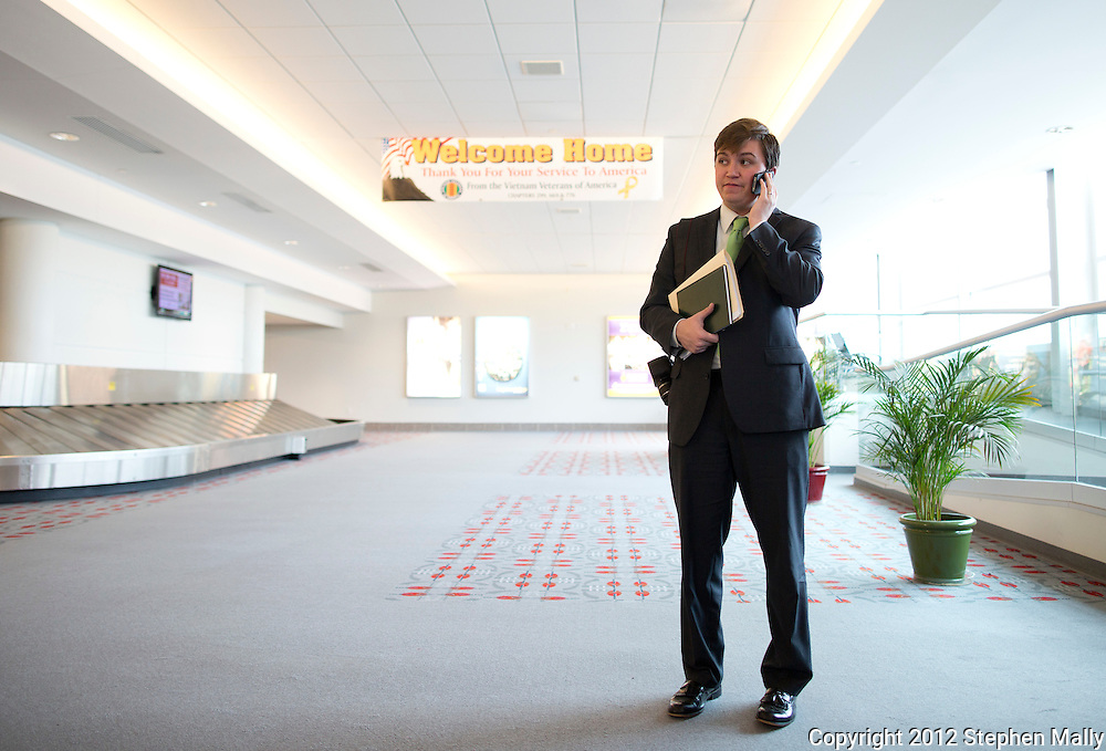 Terry Schilling, campaign manager for Rep. Bobby Schilling (R-Ill), talks on his cellphone at the Quad-City International Airport in Moline, Illinois on Monday, April 30, 2012. Terry Schilling is the son of Rep. Bobby Schilling.