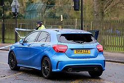 © Licensed to London News Pictures. 12/03/2019. London, UK. The damaged rear windscreen of Mercedes car. A tree has fallen on Green Lanes in Haringey, North London due to strong winds. Green Lanes is closed between Manor House underground station and Endymion Road. Met Office is warning to prepare for rain and 80mph gales as Storm Gareth hits later today bringing the risk of heavy flooding. Photo credit: Dinendra Haria/LNP