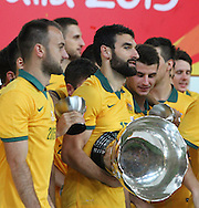 Mile Jedinak lifts the asian cup after the AFC Asian Cup match at Stadium Australia, Sydney<br /> Picture by Steven Gibson/Focus Images Ltd +61 413 768835<br /> 31/01/2015 at Stadium Australia, Sydney<br /> Picture by Steven Gibson/Focus Images Ltd +61 413 768835<br /> 31/01/2015