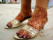 A woman's feet with henna in slipper. Yemen.