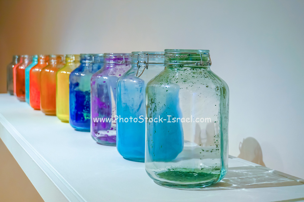 glass jars of different coloured paint