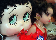 Danielle  Elizarraraz, of Los Angeles, gets a hug from a fullsize Betty Boop during the 12th Annual Betty Boop Festival in Montelbello, Calif. Danielle beat out over 60 other youngsters to  win the three-year-old category for best-look-alike.