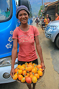 Africa, Madagascar, Portrait of young food vendor