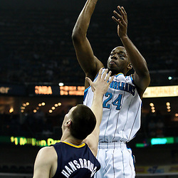 April 3, 2011; New Orleans, LA, USA; New Orleans Hornets power forward Carl Landry (24) shoots over Indiana Pacers power forward Tyler Hansbrough (50) during the first quarter at the New Orleans Arena.    Mandatory Credit: Derick E. Hingle