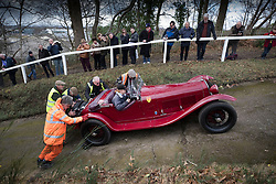 © Licensed to London News Pictures. 28/01/2018. Weybridge, UK. Driver Alex Pilkington receives help from the marshals in her 1939 Alfa Romeo 6C 1750 on the steepest gradient of the hill test at Brooklands Museum during The Vintage Sports-Car Club's New Year driving tests.  Photo credit: Peter Macdiarmid/LNP