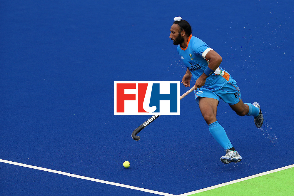 RIO DE JANEIRO, BRAZIL - AUGUST 12:  Sardar Singh #8 of India runs upfield against Canada uring a Men's Preliminary Pool B match on Day 7 of the Rio 2016 Olympic Games at the Olympic Hockey Centre on August 12, 2016 in Rio de Janeiro, Brazil.  (Photo by Sean M. Haffey/Getty Images)