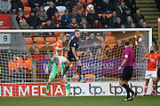 Barnsley's Marc Roberts (4) heads clear from Blackpool's Mark Cullen (9) during the The FA Cup 3rd round match between Blackpool and Barnsley at Bloomfield Road, Blackpool, England on 7 January 2017. Photo by Craig Galloway.