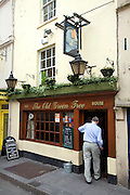 Man entering The Old Green Tree pub, Bath