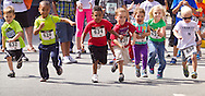 Middletown, New York - Children take off at the start of a kids race at the Middletown YMCA Funzone  during the Orange Regional Medical Center's Run 4 Downtown road race on Aug. 16, 2014.