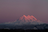 The sun sets of Mount Rainier on a cold, clear winter day.