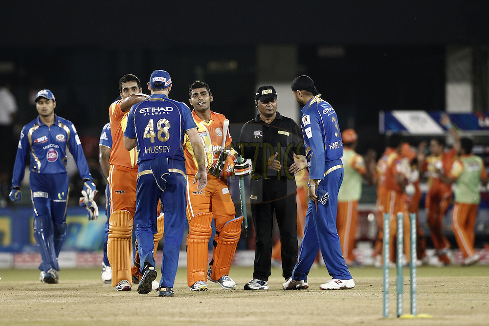 Umar Akmal of the LAHORE LIONS celebrates his win against the Mumbai Indians during the qualifier 2 match of the Oppo Champions League Twenty20 between the Mumbai Indians and the Lahore Lions held at the Chhattisgarh International Cricket Stadium, Raipur, India on the 13th September 2014<br /> <br /> Photo by:  Deepak Malik / Sportzpics/ CLT20<br /> <br /> <br /> Image use is subject to the terms and conditions as laid out by the BCCI/ CLT20.  The terms and conditions can be downloaded here:<br /> <br /> <br /> http://sportzpics.photoshelter.com/gallery/CLT20-Image-Terms-and-Conditions-2014/G0000IfNJn535VPU/C0000QhhKadWcjYs