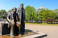 Berlin, Germany. The Marx-Engels Monument at Alexanderplatz. Berliner Dom in the background.