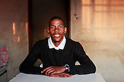 Kenny, Community Volunteer-  &quot;Mothlabe is an affected area so the village must benefit.&quot; <br /> <br /> Mothlabe is a small community in the midst of the Platinum belt North of Rustenburg. During the apartheid era they were forced under the rule of a neighbouring Traditional Authority and the village boundaries redrawn.  In the late 1990&rsquo;s they submitted a claim for land restitution but the claim came back as a failure but no reasons where given. They have since appealed but heard nothing. In 2004, a platinum mine began operating on the land in question and it&rsquo;s profits have been used to develop other villages. When the Mothclabe community proposed independence by forming their own Traditional Authority they were issued with a court interdict preventing them from holding meetings and using the term &lsquo;Mothlabe Traditional Authority.&rsquo;  The Legal Resources Centre has since successfully defended them in court against the interdict. Meanwhile Mothlabe remains poor and restitution of their land is no closer.  <br /> <br /> Mothlabe, North West Province, South Africa. 2011<br /> <br /> &copy;Zute &amp; Demelza Lightfoot / Legal Resources Centre