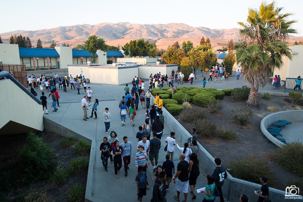 Parents and students walk through campus in between classes during Milpitas High School's Back to School Night at Milpitas High School in Milpitas, California, on September 1, 2015. (Stan Olszewski/SOSKIphoto)