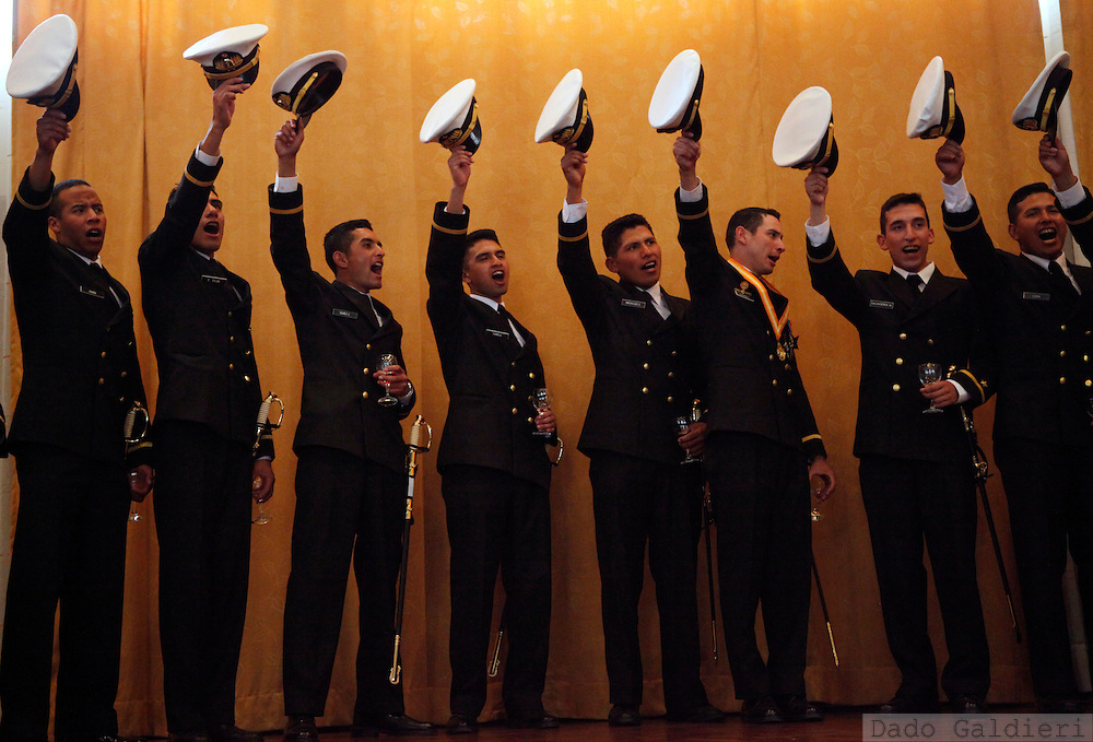 Bolivian Navy officers raise their hats while celebrating their graduation at a Military College in La Paz, Thursday, Dec. 10, 2009. (Photo Dado Galdieri)