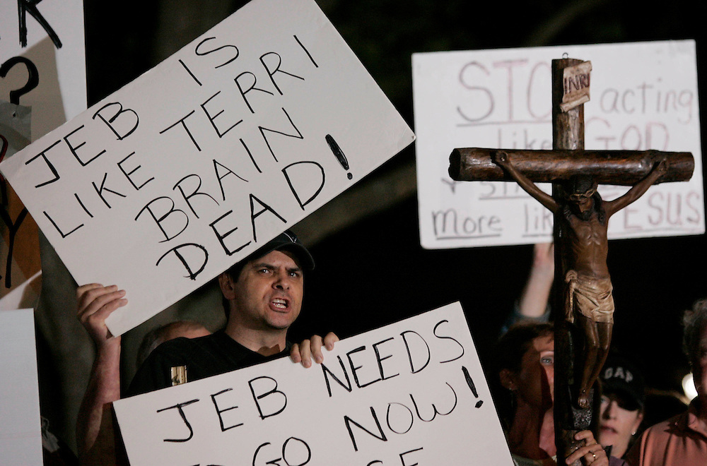 Dave Giannino (L) of St. Petersburg, Florida shouts at Terri Schiavo supporters  about the Florida Governor Jeb Bush's involvement thus far in the Terri Schiavo case outside of the Woodside Hospice on March 23, 2005 in Pinellas Park, Florida. REUTERS/Scott Audette