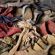 Detail of massacre victims' clothing, laid out on pews in Nyamata Church memorial, Rwanda Genocide